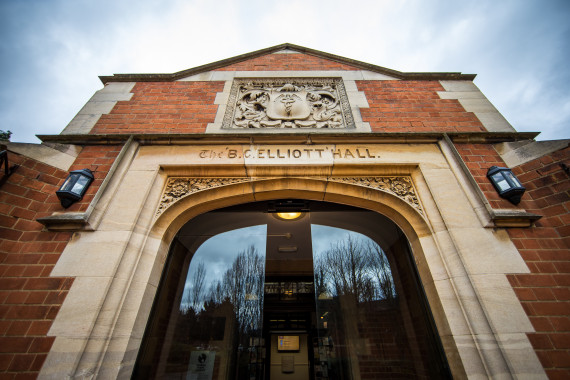 A front view of the main door of the Elliott Hall
