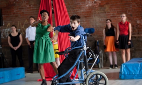 A young man in a rollator dancing