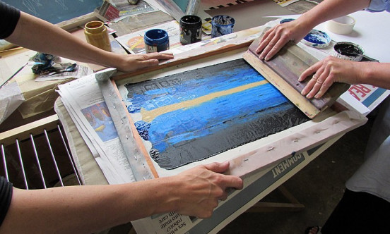 two artist completing a screen print