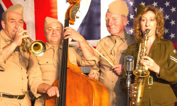 Musicians dressed in traditional World War dress playing instruments