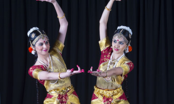 Two Kathak dance studios in pose