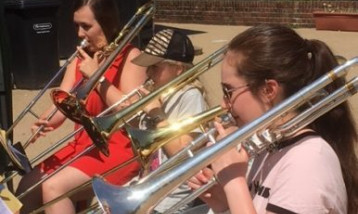 A picture of the brass band playing brass instruments.