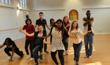 A picture of 11-16 year old children taking part in the Youth theatre.