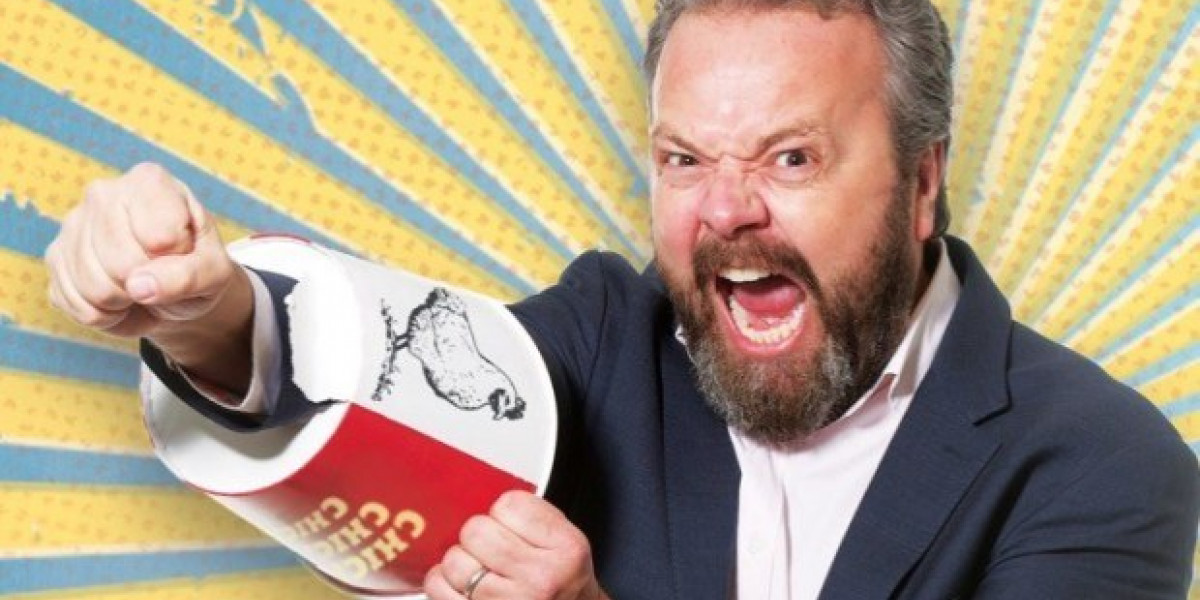 A picture of Hal Cruttenden punching through a chicken bucket.