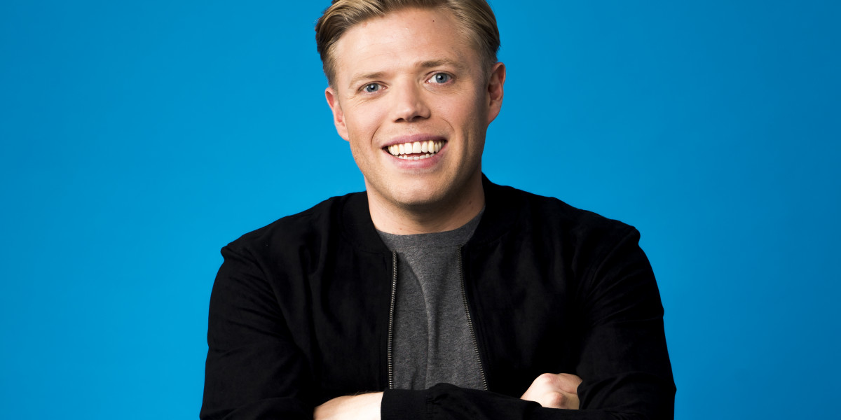 A picture of Rob Beckett standing with his arms crossed representing his comedy event.