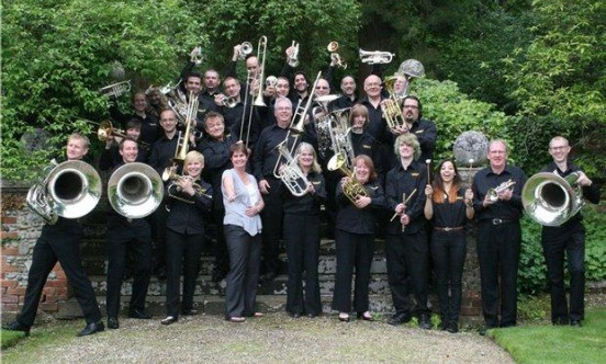 A picture of Grimsdyke brass band altogether with their instruments outside.
