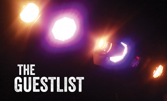 "Orange and purple spotlights shining down with the logo ""The Guestlist"" on the bottom left hand corner."