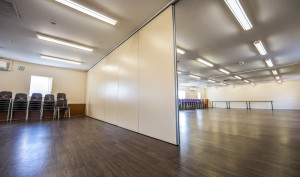 A picture showing how the big room can divide into two using moving doors.