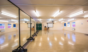 A side view of the Greenhill Mirrors rehearsal space.