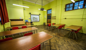 A picture of the Stanmore classroom with chairs and desks.