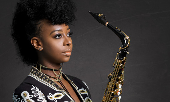 An image of YolnDa Brown holding a saxophone