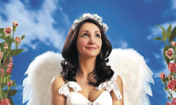 Lucy Porter wearing angel wings