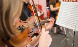 A women playing a violin